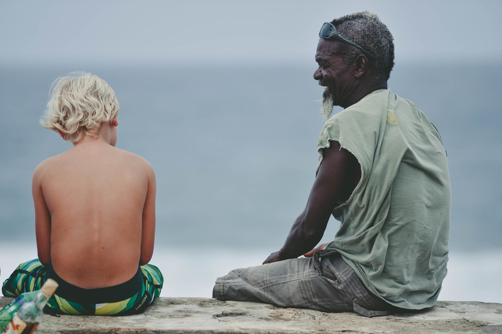 Snake, also considered the founding father of Barbados surfing, here chatting with a young surfer in Bathsheba