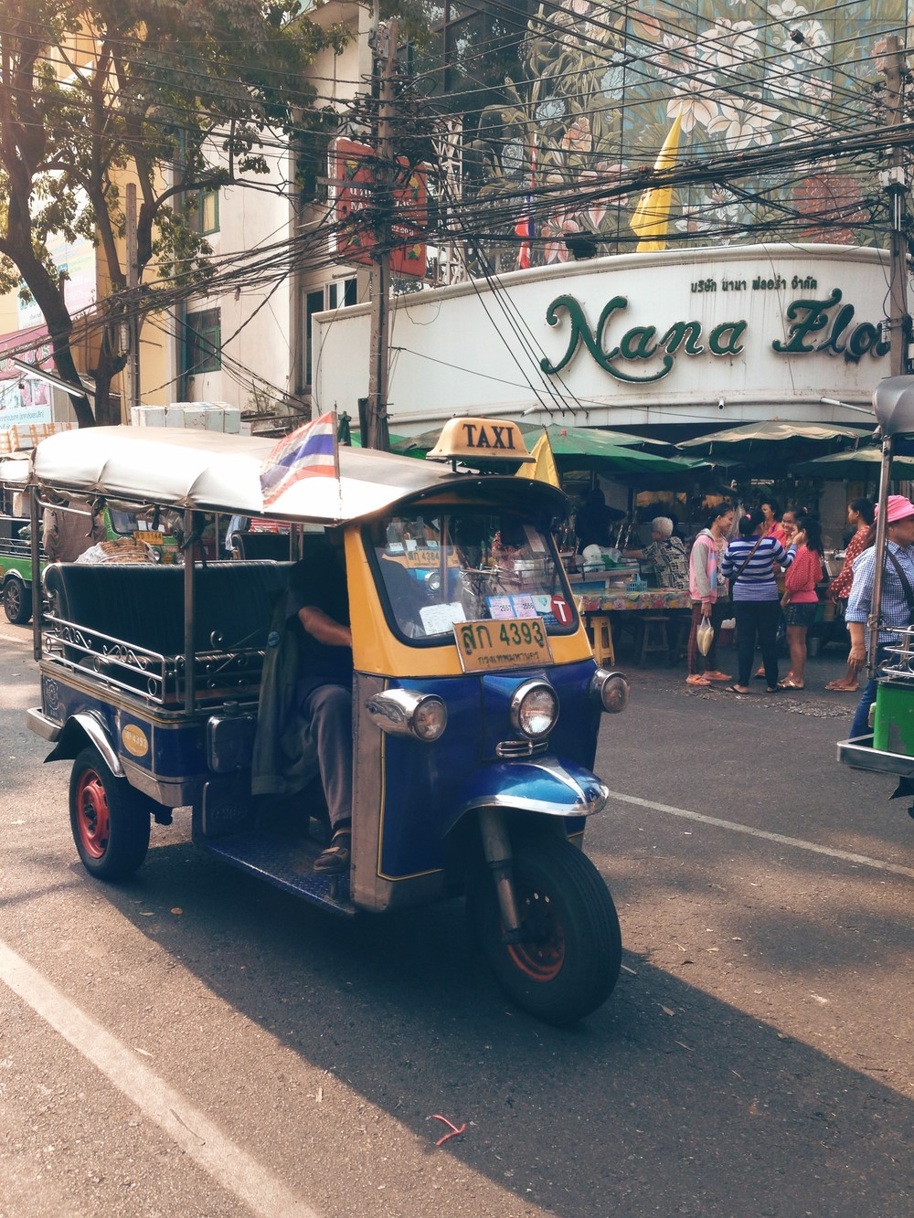 Tuk tuk vehicles flood the streets of Bangkok, used by merchants and locals alike