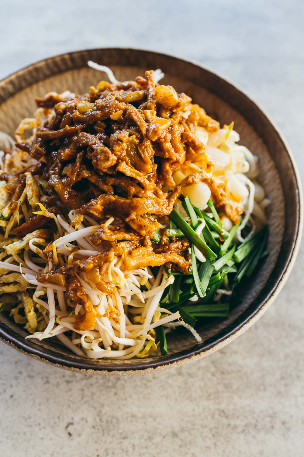 Cambodia - Royal Mak Mee : Crispy fried noodles topped with pan-fried sliced pork, marinated in Kroeung and fragrant lemongrass, and slowly cooked in coconut milk / Image: Malis restaurant
