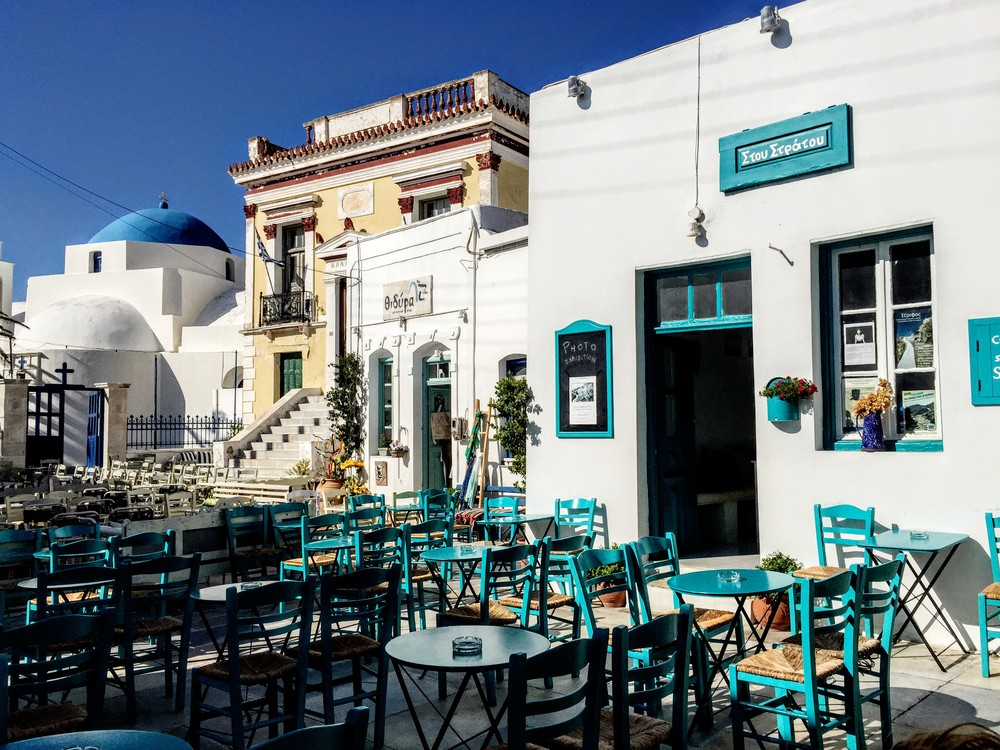 """Serifos signature square atop a hill, with """"Stou Stratou"""" traditional caféas the main attraction... old day long"""