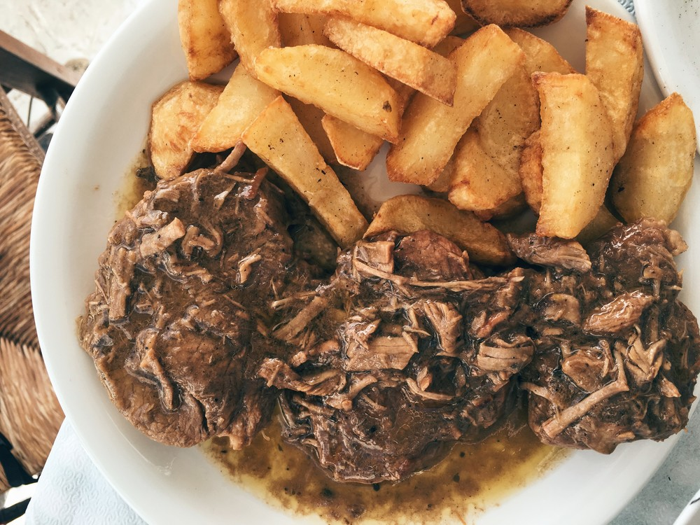 Traditional veal slow-cooked in the pot, served with thick-cut fried potatoes