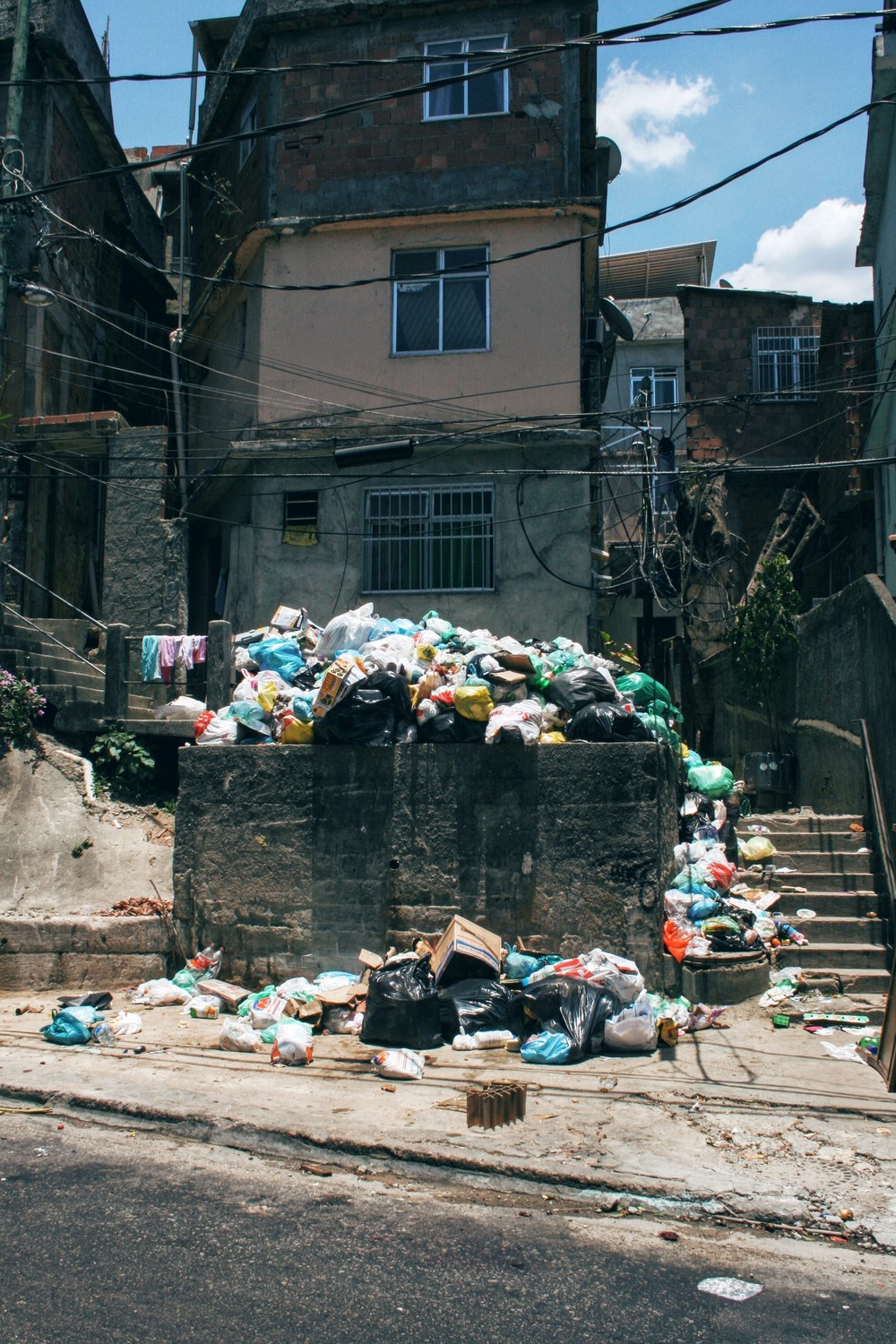 Stark contrast between the rich and the poor, favelas in ruins and full of garbage
