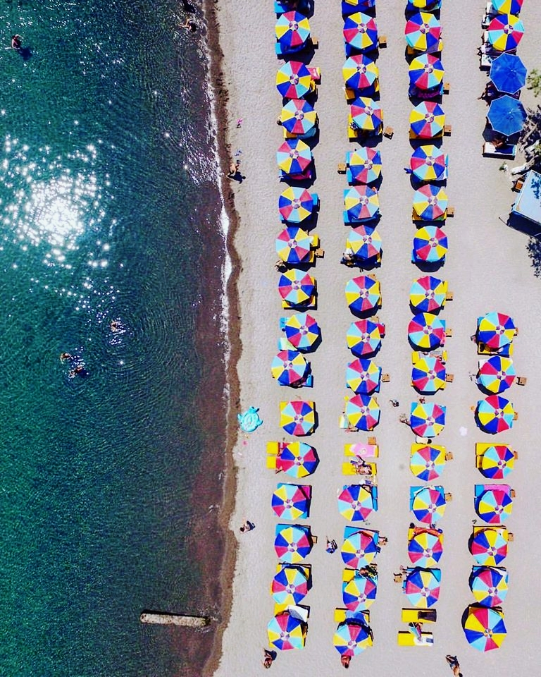 Colored umbrellas at Kambos beach