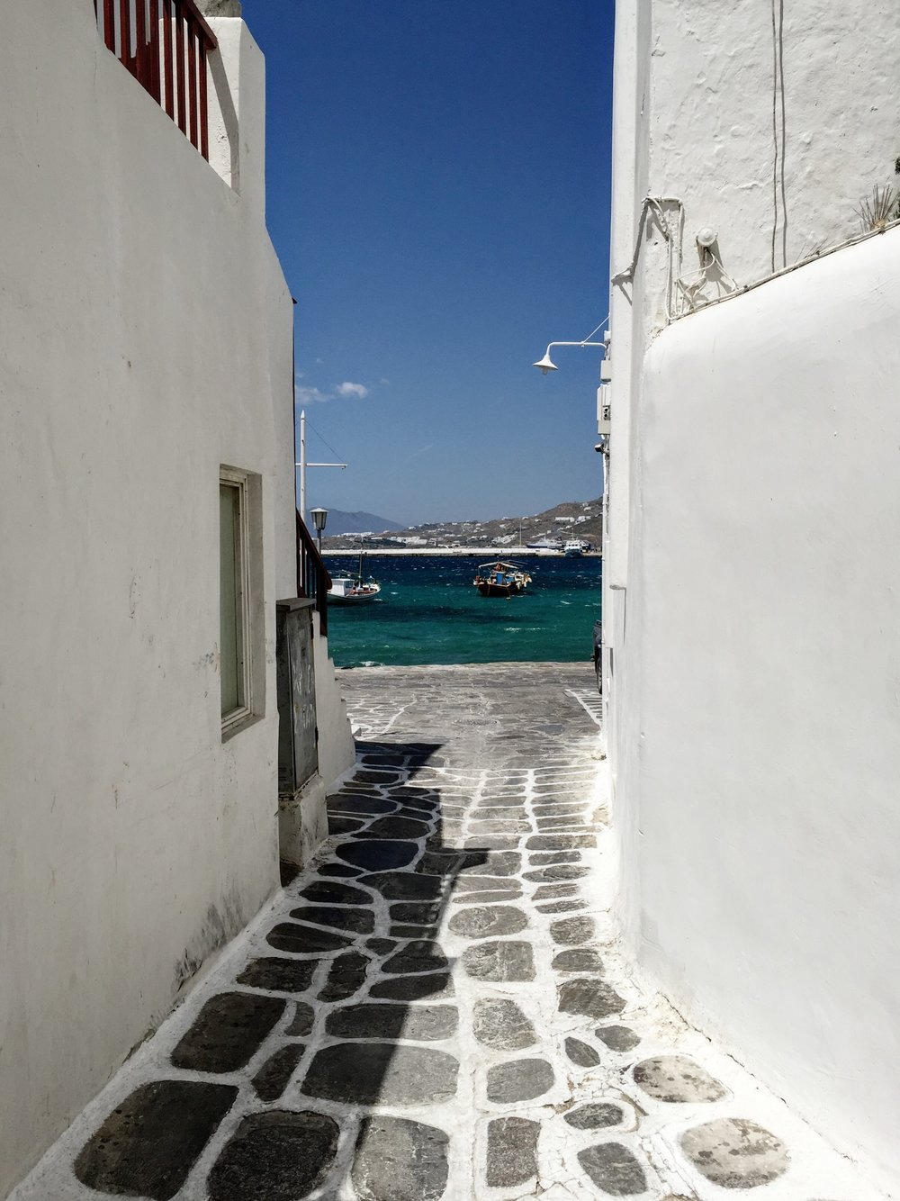 The streets of Mykonos,  tile paved and white washed in their edges
