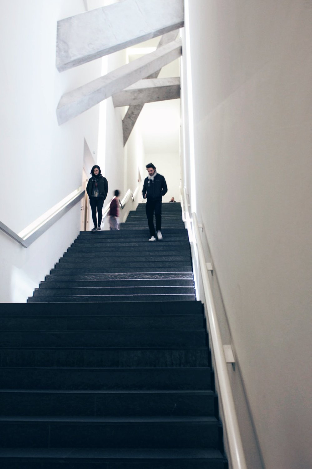 The Stair of Continuity emphasizing the continuum of history. Climbing eighty-two steps, visitors reach the entrance to the permanent exhibition two stories up.