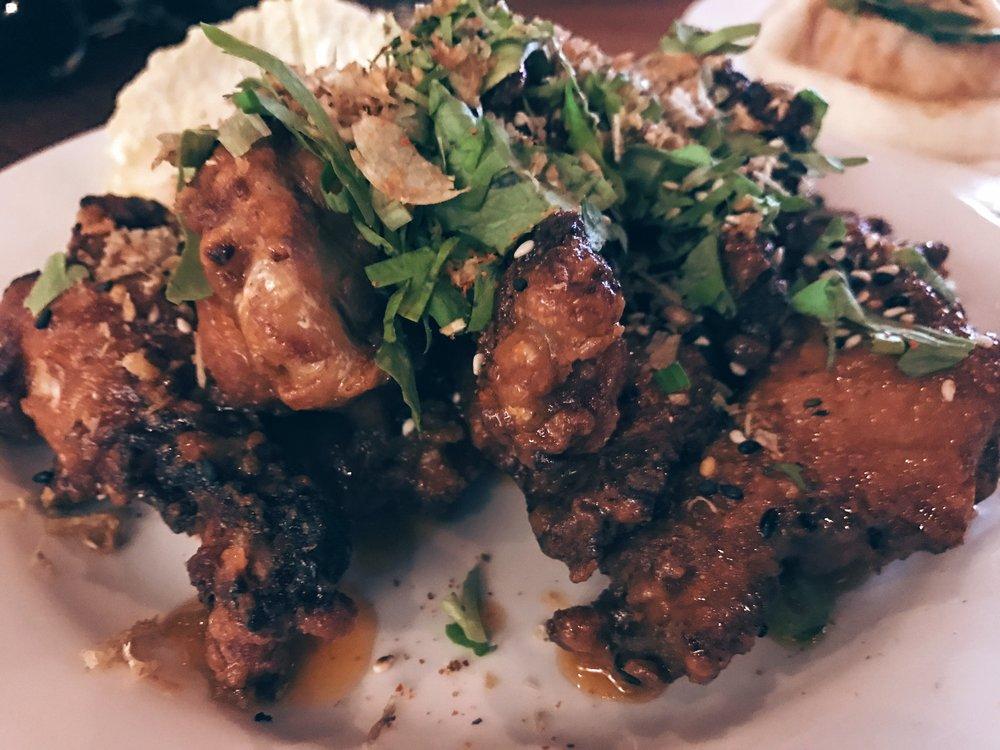Honey glazed crispy chicken wings, sprinkled with sesame seeds