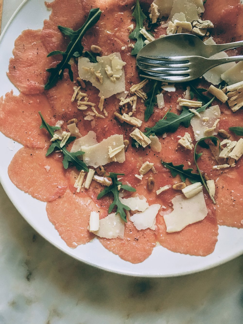 Beef carpaccio sprinkled with foie gras shavings, parmesan cheese and rocket, at Pizzaria Lisboa
