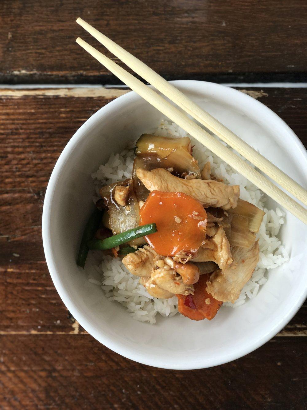 Chopsticks on cashew chicken at Neon Asian Street Food