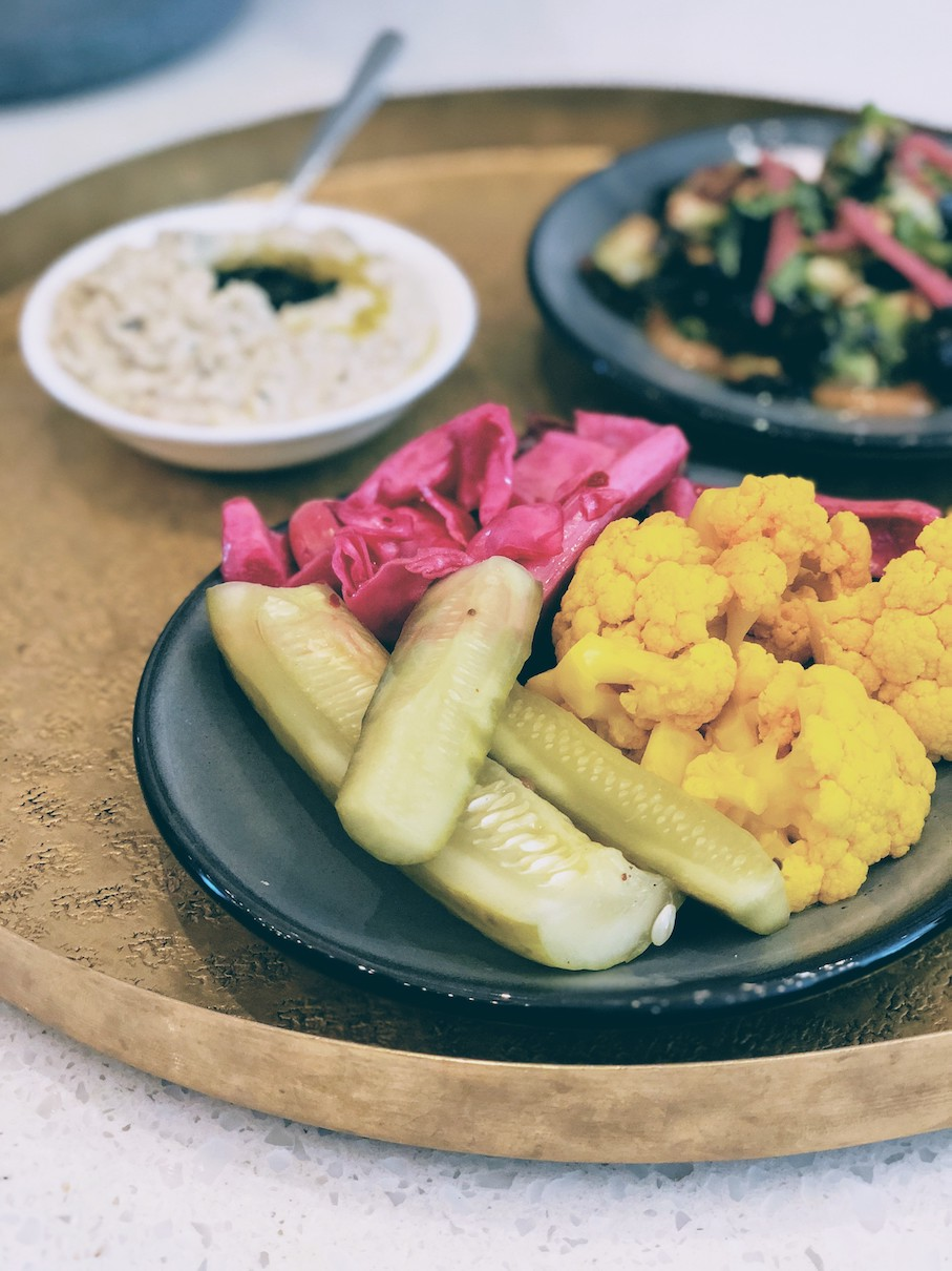 Pickled vegetables with some hummus in the background