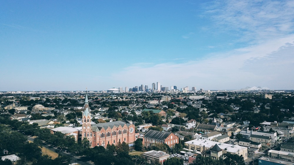 Aerial view of Magazine street, Uptown with Downtown NOLA in the background