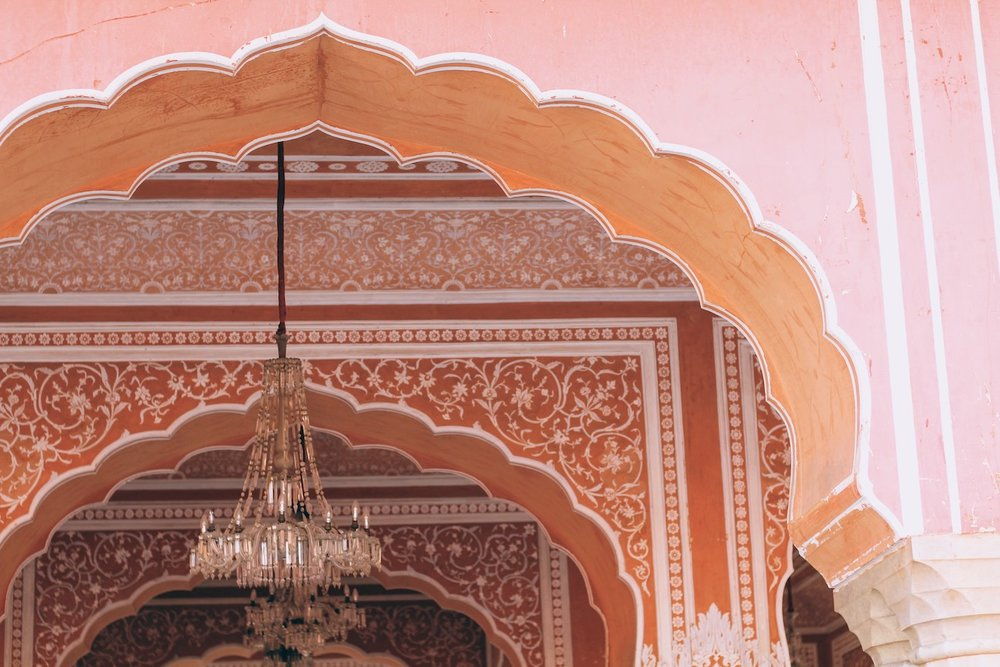 A city of Pink - a pink pavillion of the City Palace, the terrace of the Anokhi museum, and the Hawa Mahal.