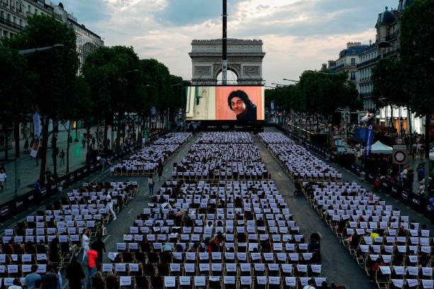news champs elysees transforms into a big open air cinema for a