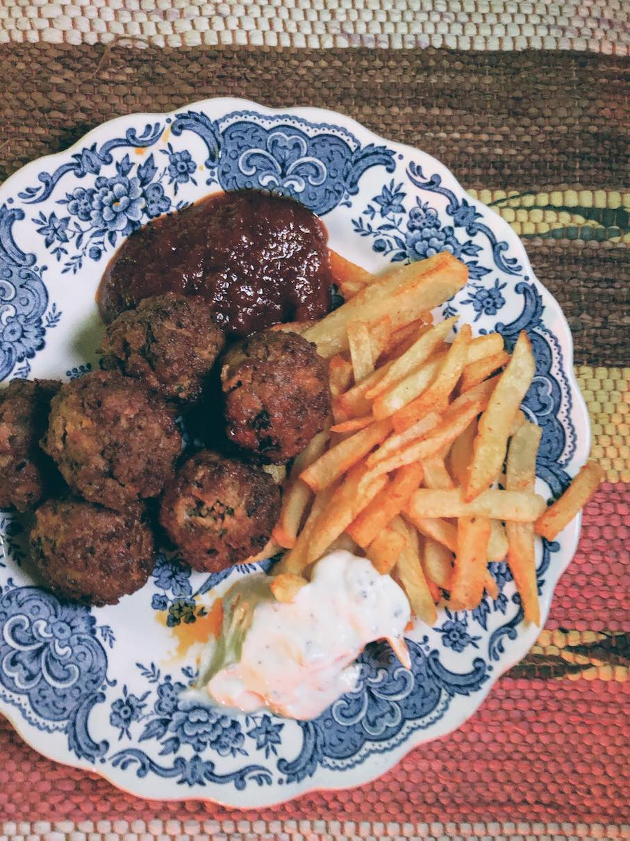 Lightly fried chorizo meatballs with pepper marmalade and french fries