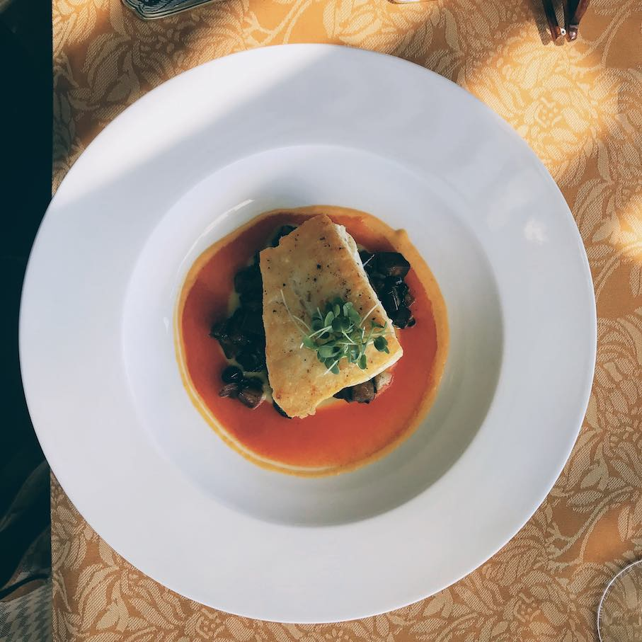 Northern halibut with a grilled eggplant caponata, walnuts, rouille in a tomato jus