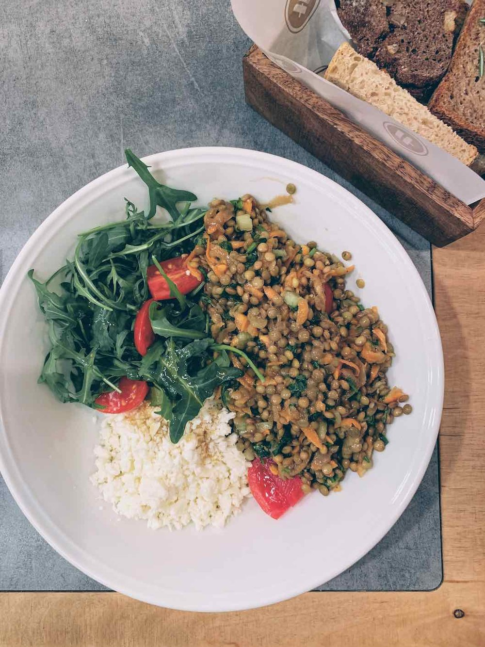 Lentil salad with crumbled cheese and wild rocket salad