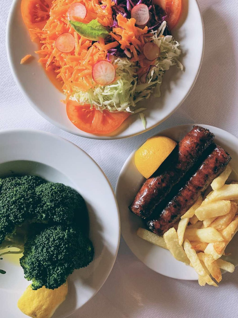 Salad starters and grilled sausage