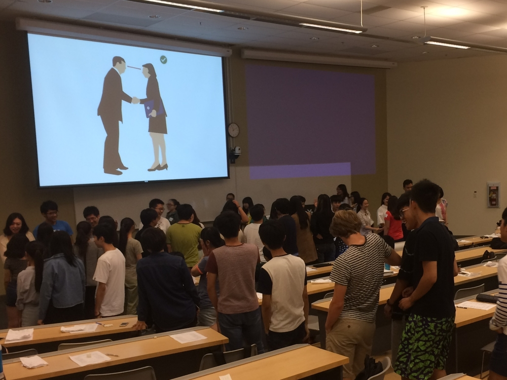 international first-year students during hand-shaking exercise.