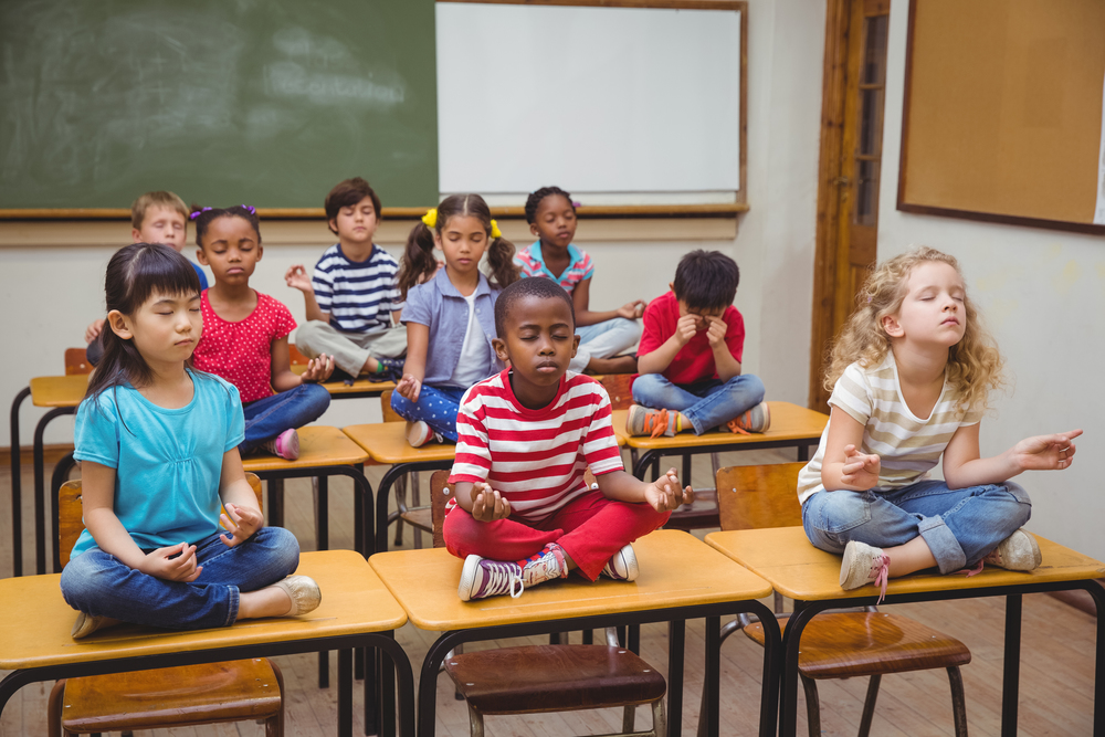 children meditating in class
