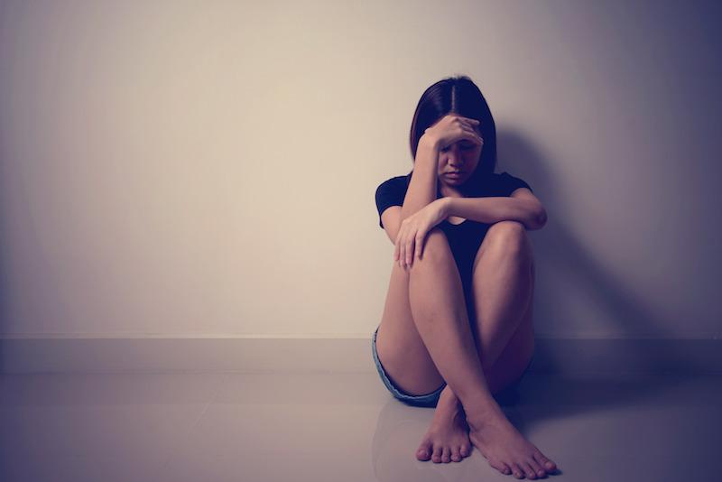 sad woman on floor