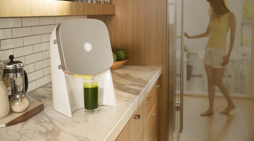| Source: Juicero | The Juicero Juice Presser, Pressing a Green Juice