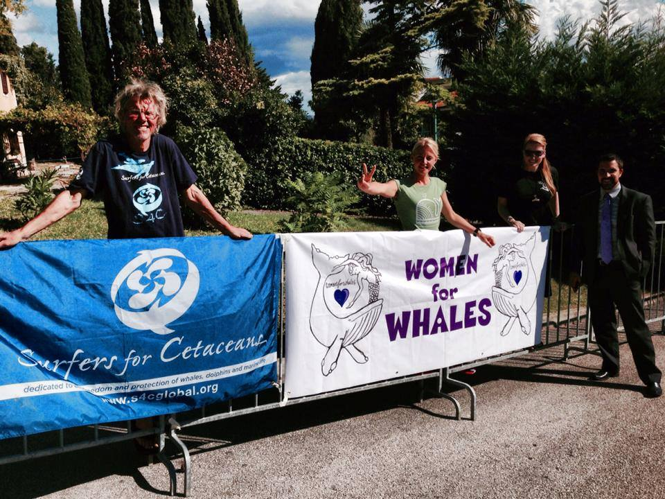 Our brother Howie from Surfers for Cetaceans stands along side Natalie from W4W - peacefully protesting -at the 2014 International Whaling Conference