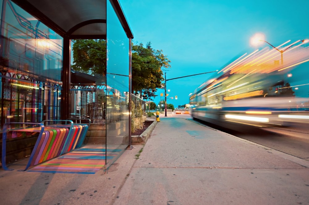 colors and architectural elements make this bus stop attractive and inviting