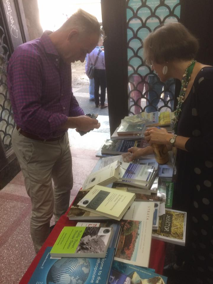 Professor Sverker Sörlin making a purchase at the ESEH conference in Zagreb. ICEHO President Verena Winiwarter collects the donation.
