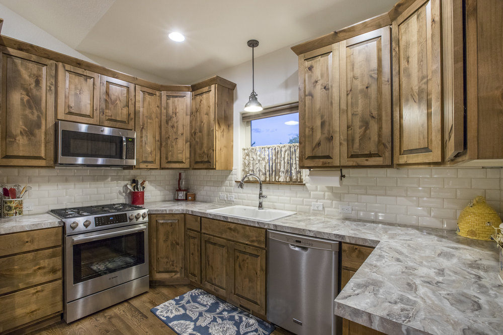 Knotty Alder Cabinets by Tharp