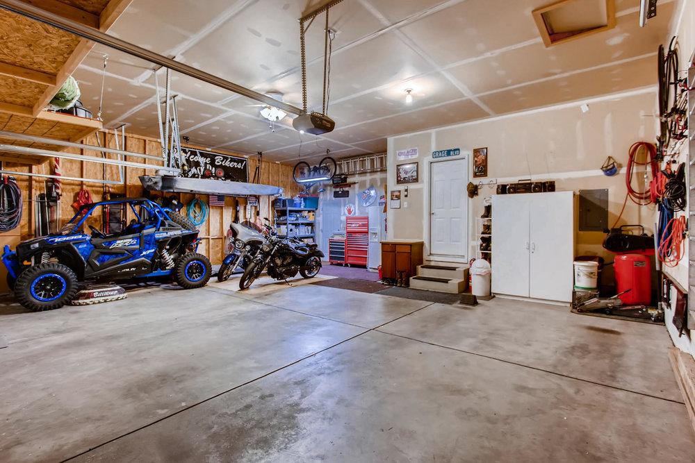 Oversized 3 Car Garage W/ High Ceilings