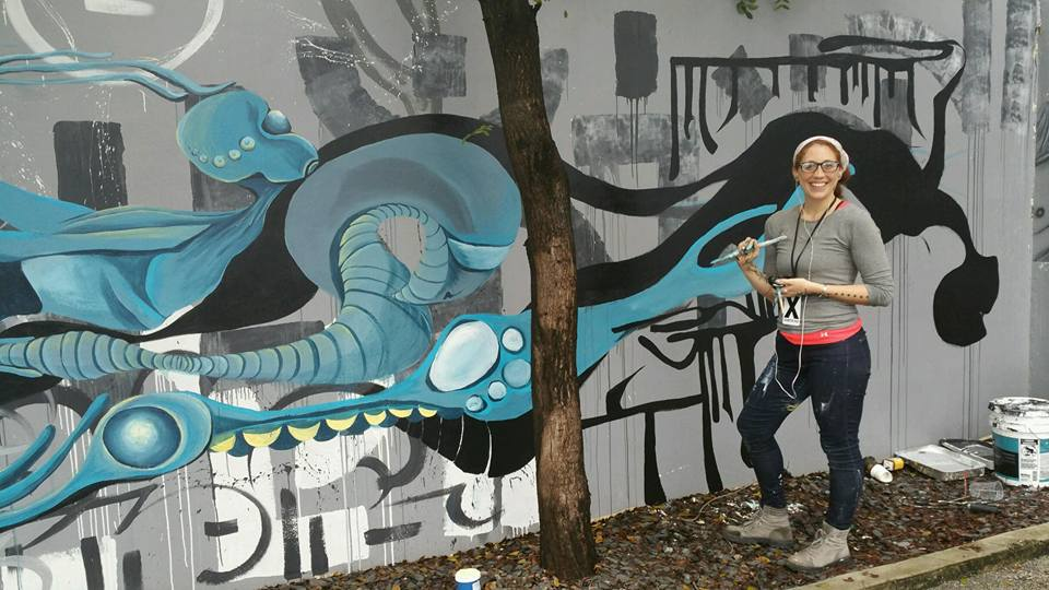 Lana Price working on a mural in Miami Art Basel