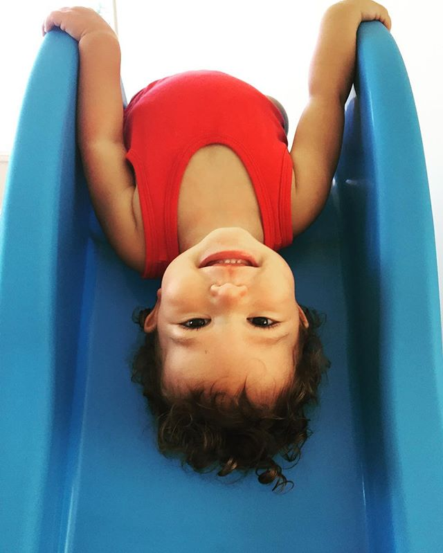 Look at that smile! Hanging upside down on the snail slide! She's ready to join the circus! #nail_snail_baby #thatkidisfearless #jointhecircus #upsidedown #smile #gorgeouscurls #ihadtohelpherdown #shegotstraightbackupagain #lovethatsmile