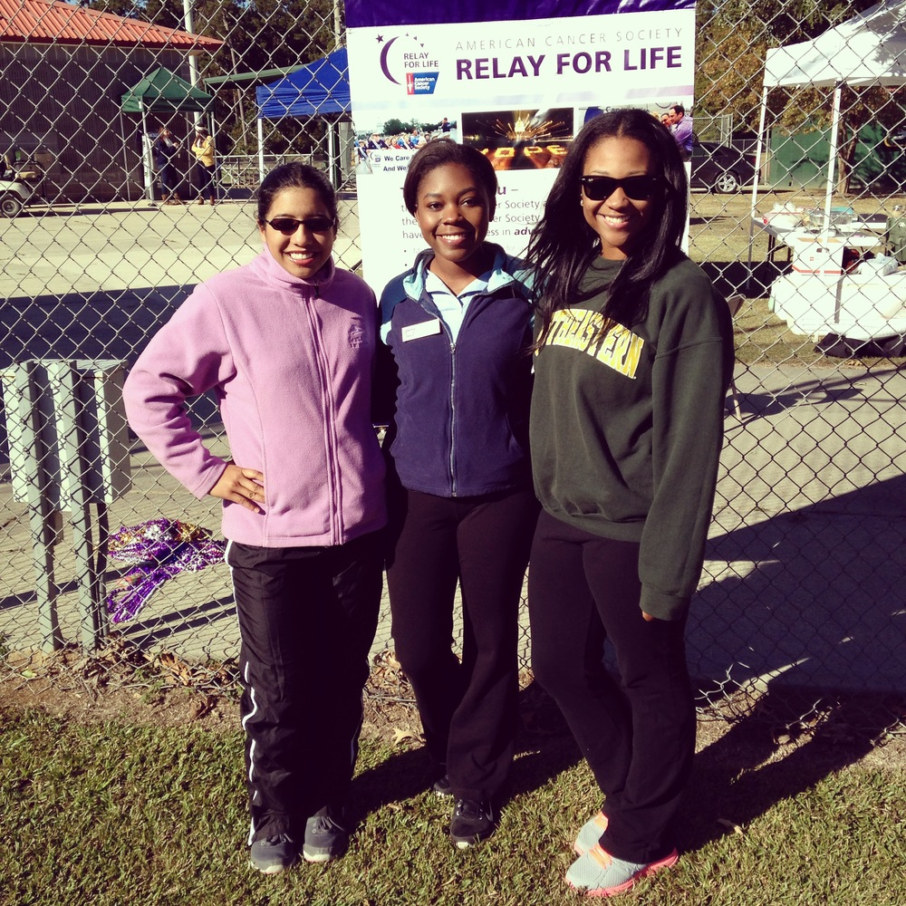Jasmine poses with PRSSA members, Maria Goddard and Jada Davis, at the 2014 Relay For Life.