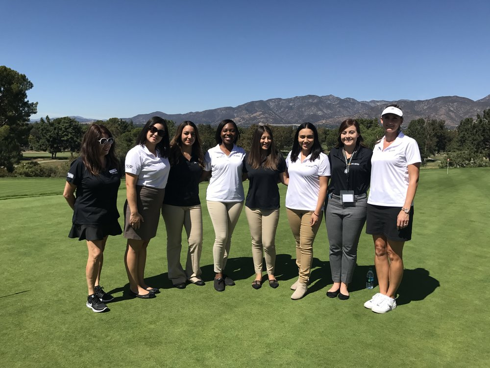 The ladies of IEUW come together for a photo during the 2017 IEUW United for Kids Golf Tournament.