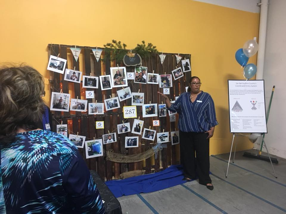 Gail Maddox, member of the 211 Pathways Home Outreach Team, shares stories of those housed during the 211 celebration of the program's one year anniversary. photo courtesy of IEUW