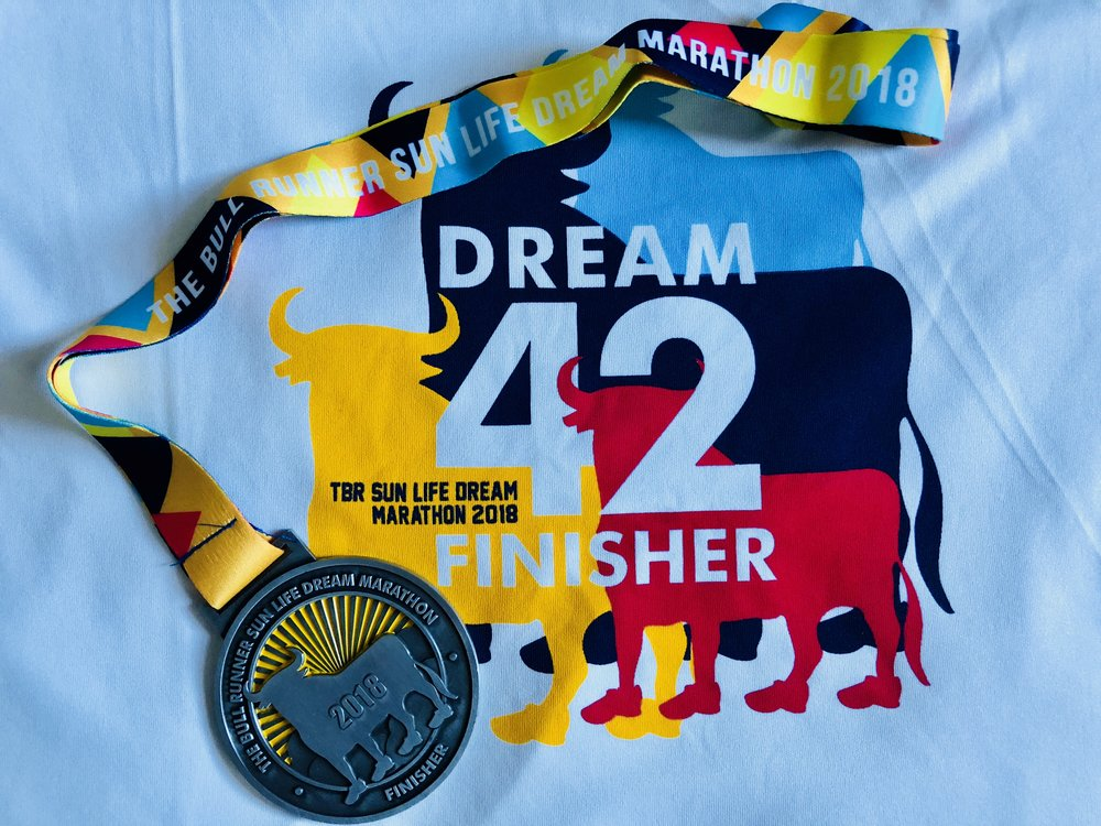 My finisher shirt and medal after completing the marathon