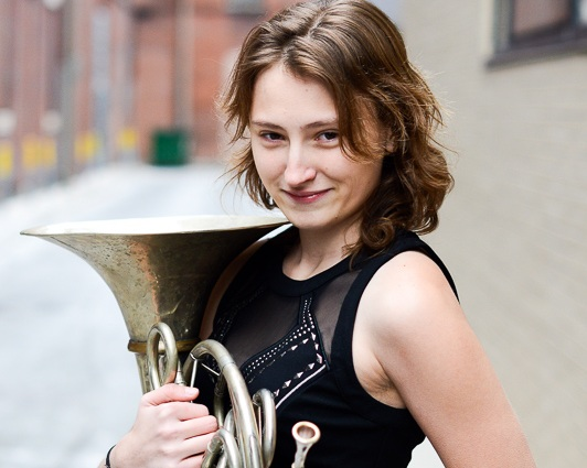 "Steph Smith - Steph Smith was predestined to excel as a professional french horn player. Born into a family of musicians, she is a third generation horn player who has inherited artistry that simply cannot be taught.Originally from Park Ridge, Illinois, Steph relocated to Boston, Massachusetts in 2010 to attend the Boston Conservatory. In 2014 she graduated with a Bachelors of Music in french horn performance.Recognized as an up-and-coming artist Steph has received a Boston Conservatory Artistic Merit Scholarship, the Chicago Federation of Musicians Scholarship, and the James D Sedlack Memorial Scholarship to aid her towards becoming a professional musician.Steph's musical experiences span farther than the range of the instrument itself. While attending the Boston Conservatory she was trained to perform for all mediums and styles of performance art, including dance, combined chorus, musical theater, opera, wind ensemble, brass ensemble, chamber music, and orchestra.Steph was reviewed positively as a sensitive player during a performance of Mozart's Don Giovanni.""...and the difficult horn parts (This is, after all, an opera in which cuckoldry is important) stood out with bright but never overbearing sound"" -The Boston Musical Intellegencer.Steph was honored to be selected to perform in the late Gunther Schuller's Progressive Jazz Orchestra conducted by the Schuller himself during the Boston Conservatory's New Music Festival in 2011. She is an active performing chamber musician in the Greater Boston area. Most recently, Steph was a founding member of 4Play Horn Quartet which was awarded first place at the 48th International Horn Society Symposium's horn quartet competition. The quartet was honored to perform on one of the final featured artists performances. Steph was a founding member of the woodwind ensemble The Niji Quintet, best known for its extensive community outreach. The quintet was selected to perform as featured artists of the Museum of Fine Arts' Community Concert series in 2014. Two of Steph's chamber ensembles have won the Boston Conservatory Honors Chamber Music Competition, once in 2011, and again in 2013.Steph's orchestral opportunities have taken her to locations that musicians only dream about. She has performed in Boston's Symphony Hall, Chicago's Symphony Center, New York's Carnegie Hall, Rotterdam's de Doelen, and Amsterdam's Concertgebow. Locally Steph has performed as a member of the Haffner Sinfonietta, East Coast Scoring Orchestra, and Brookline Symphony Orchestra. She has also substituted for the Boston Philharmonic as well as performed as a utility player for the Park Ridge Civic Orchestra in Illinois.Steph studied under esteemed french horn pedagogues Eli Epstein, Melanie Cottle, and Dorothy Katz. She has been coached by world renowned musicians Geralyn Coticone, Adrian Morejon, and Naomi Bensdorf Frisch. Steph has also performed in Master classes with notable artists James Somerville, Jason Snider, Luca Benucci, Norman Bolter, Joan Watson, Tage Larson, and Dale Clevenger. When not performing Steph is either teaching private lessons or is on location shooting head shots for musicians as a freelance photographer"
