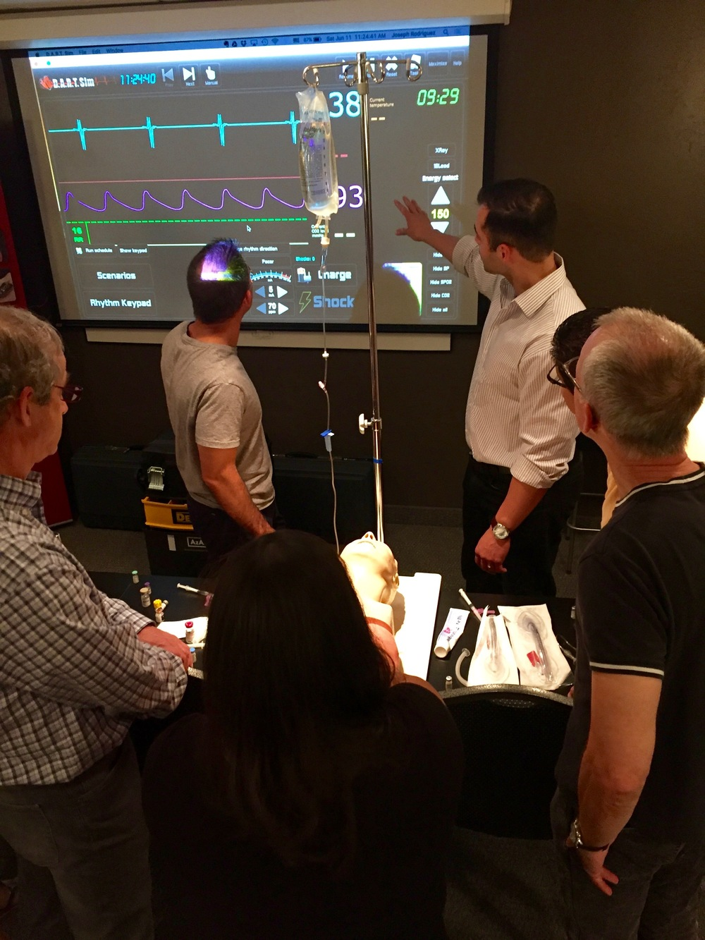 Joe Rodriguez, CRNA, reviews emergency heart rhythm management. Pictured here with Drs. Ken Kimble, DDS, Ralph Price DDS, and Alan Ferguson, DDS.