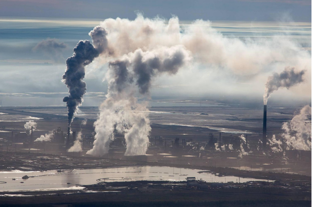 mpdrolet :      Steam and Smoke Rise from Upgrading Facility at Syncrude Mildred Lake Mine, 2015     Alex MacLean