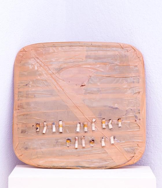 oculablog: UGO UNTORO -Penuggu #1, 2015, Cigarette buds, masking tape, plastic container, 4.5 x 42 x 42 cm, Image courtesy of Gajah Gallery