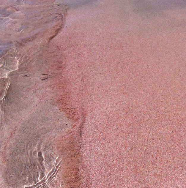 malformalady :   Pink Sand of Elafonisi Beach in Crete. The sands of Elafonisi are white is some places and have a distinct pink  hue in others. The rose colored sands are caused by particles from pink  coral and shells that have been ground into fine sand by years of  erosion.
