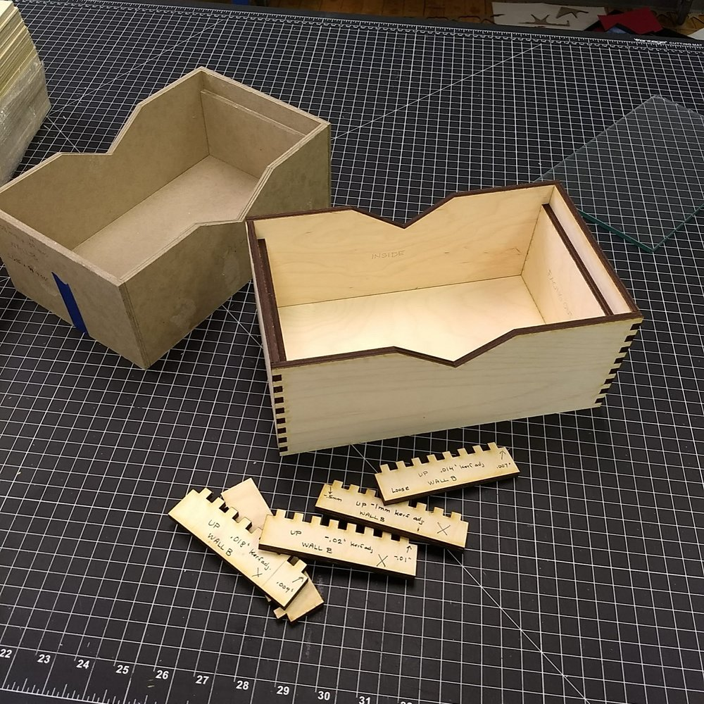 mock-up (left) - prototype (right) - kerf tests (front)