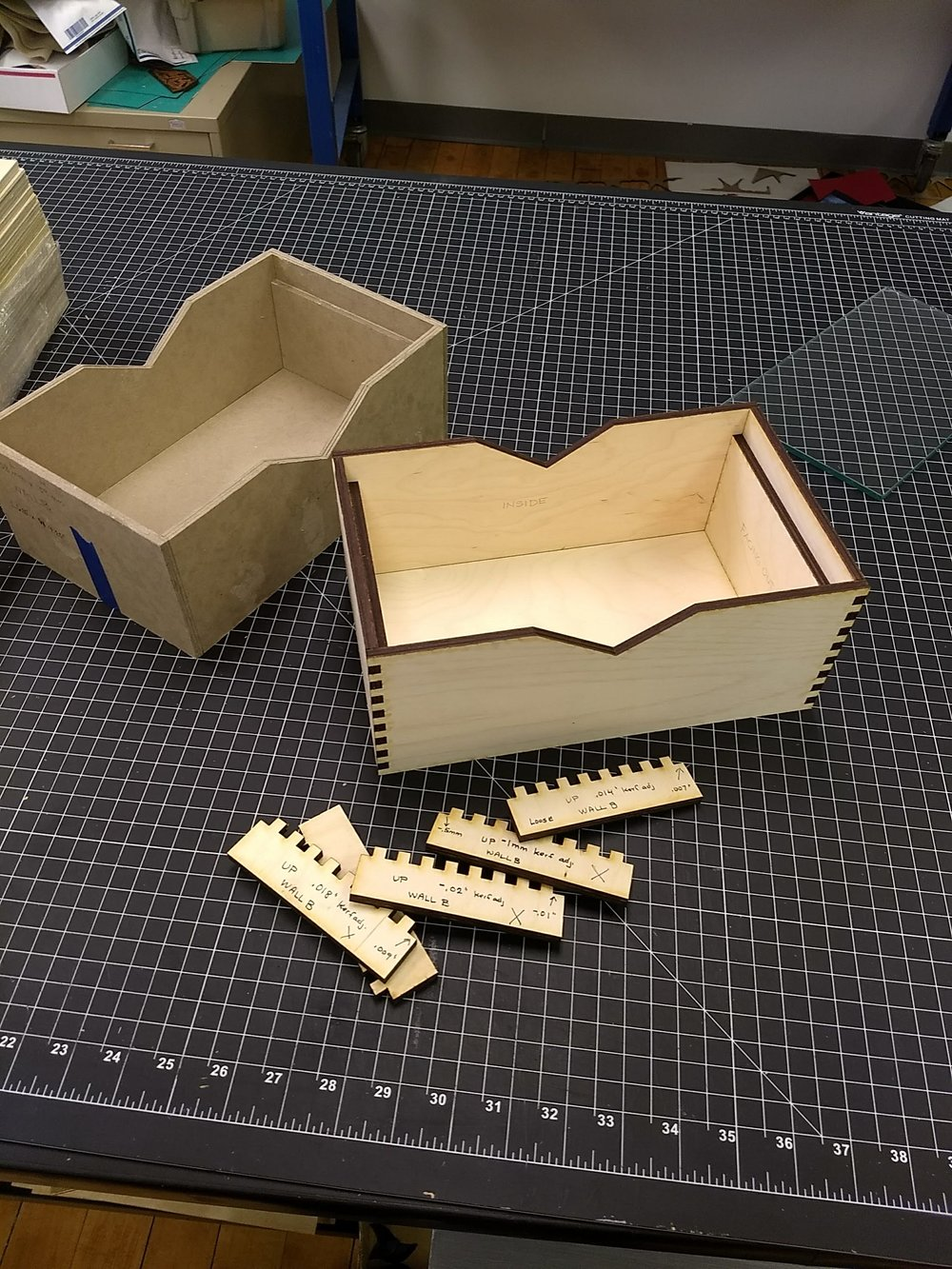 Sarah's mock-up (left) - kerf tests (front) - prototype (right)