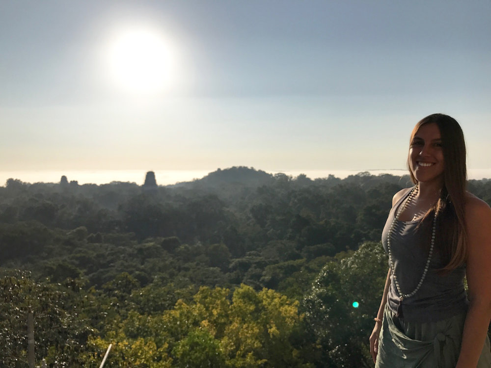 co-founder stephanie at tikal temple iv at sunrise