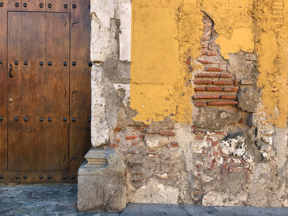 charming yellow and brick building in Antigua, Guatemala
