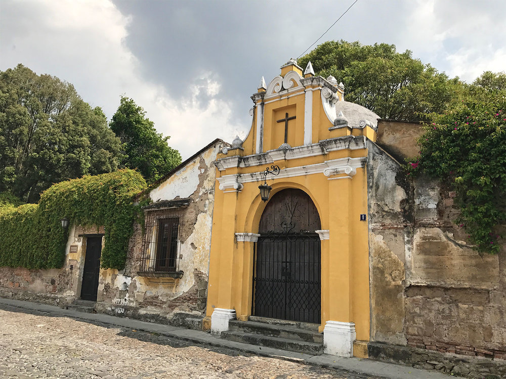 yellow church and cobbled streets in Antigua Guatemala