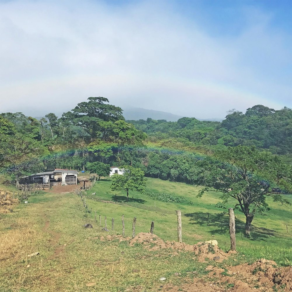 DOuble Rainbow at the end of ziplining in costa rica