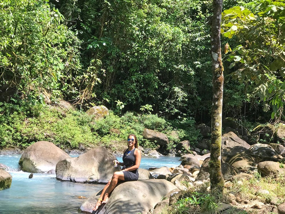 sapphire & elm co-founder stephanie enjoying a local beer and day on rio celeste