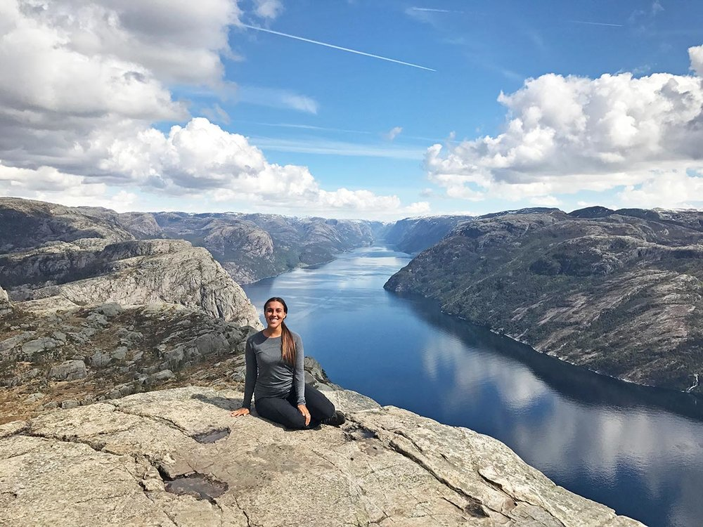 Sapphire & Elm Travel Co-Founder,   Stephanie  , on top of Preikestolen