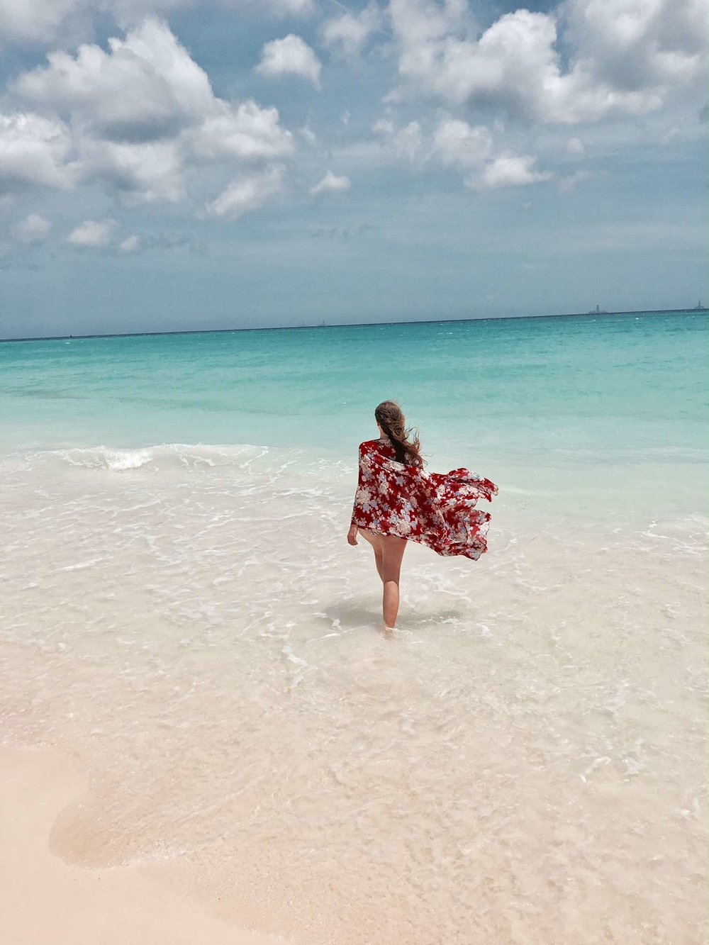 Sapphire & Elm Travel co-founder   Carly   enjoying Aruba's beaches