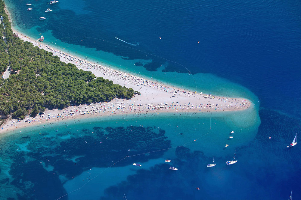 the famous bol beach on brac island, croatia by  Jeroen Komen . photo was brightened up.
